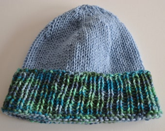 Hand knitted unisex beanie hat, blue with variegated cuff