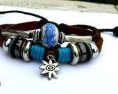 art peaceful brown leather bracelet with wooden bead and hollowed tube