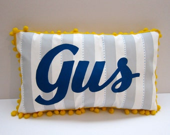Baby pillow in light gray stripes and navy blue script. Personalized with name.