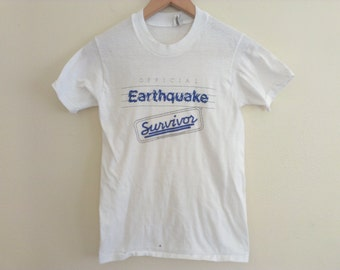 80s vintage eighties funny earthquake extra small XS tshirt has a very small spot on bottom front