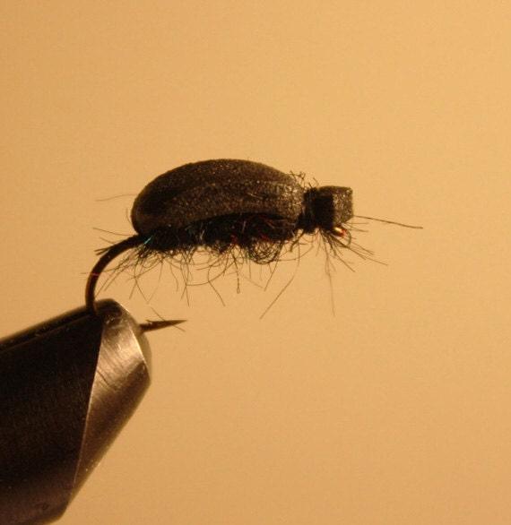 Fishing Flies - 4 Pack - Black Foam Beetle on number 10 hook. Black synthetic fiber with Blue and Red Metallic Flecks.