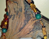 Necklace & earring set in rich earth tones. Beads of every sort - handmade, glass, copper, gold metal.
