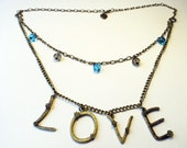 LOVE antiuqe bronze necklace, charm & blue tawny crystal