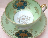 Stunning Tri Footed Green and Gold Teacup and Saucer- Royal Sealy, Japan