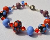 Indigo and Orange Lampwork Bead Bracelet
