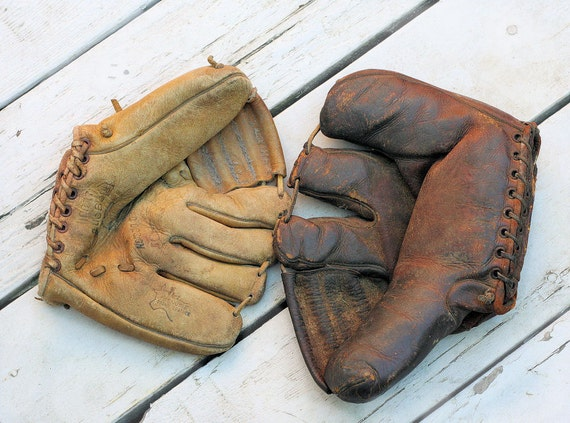 two vintage baseball mitts, a Rawlings and a Regent