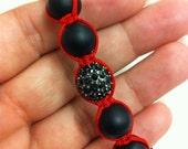 Matte black onyx shamballa-like bracelet, 1 center black Pave bead, on red string. / may choose diff. string color
