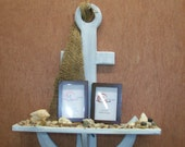 Anchor shelf with picture frames.