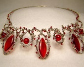 Necklace: Dramatic oval red beads on silver wire