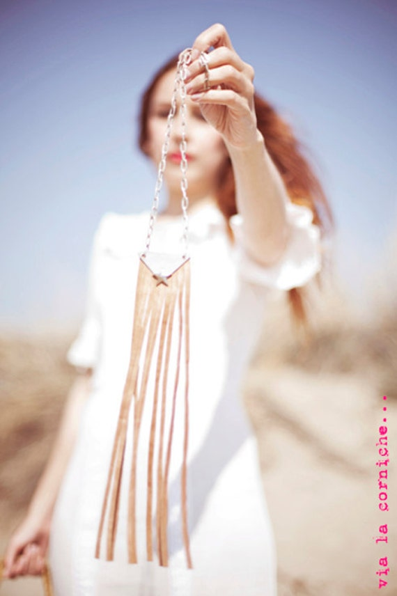 Leather fringes and metal necklace