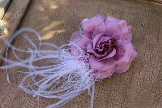 Very  cuter  flower with feather and beads