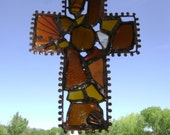 A brown rugged cross from discarded glass