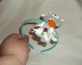 White silk overstack boutique hair bow with a glittery fish, sun and boat accent.  On aqua cloth covered headband