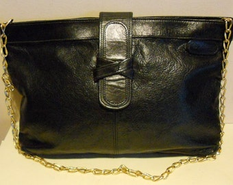 Gorgeous Italian vintage black leather clutch , evening bag with gold coloured chain