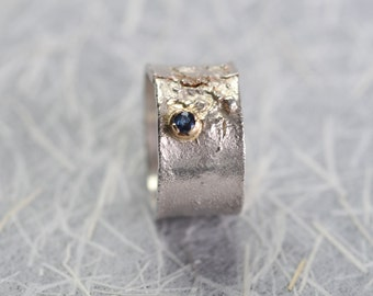 Handmade silver ring with blue sapphire set in gold