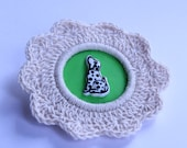 Dalmation dog with green setting and cream crochet cotton doily surrond badge / brooch. FREE delivery in Oz