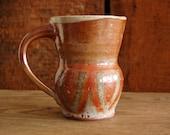 copper colored mug with retro pattern