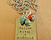 Hand stamped stainless steel pendant personalized with names and colorful stone beads.