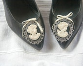 Cameo shoe clips in black, pearl and silver tone with cream ribbon detail