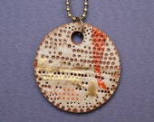 Gold and orange pendant. Stoneware necklace.