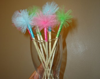 Drink Stir Sticks with Mini Tulle Puffs in bright colors.