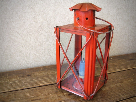 Hanging red candle lantern with glass panes