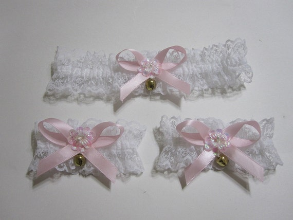 White lace choker and cuffs // pink ribbon // bows // bells // white flowers