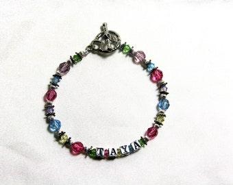 Multi-color swarovski and sterling silver name bracelet.