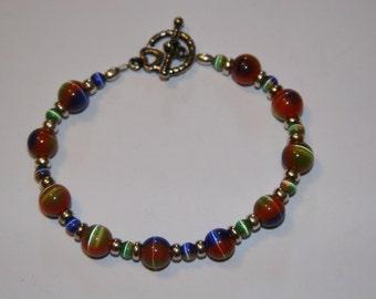 Multi-color Cat's Eye and sterling silver bracelet.