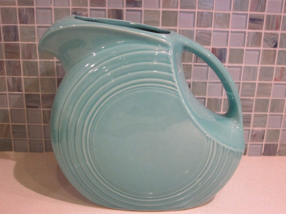 retro turquoise blue Fiesta Ware disc / disk water pitcher - vintage collectible