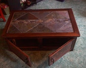 slate top coffee/ entertainment table with black grout and double sided doors