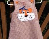 Girl Tiger Applique on orange and blue jumper