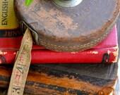 Vintage leather tape measure. Vintage tool.