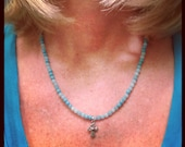 turquoise bead necklace with silver cross pendant