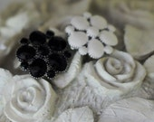 Black and White Enameled Brooches