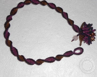 Purple and Bronze Spiral with Floral Motif
