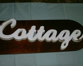 Cute white colored Cottage wall hanging.