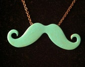Hand painted blue liquid patina mustache necklace.