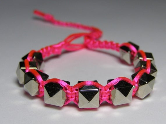 """Neon pink braclet with silvery """"studs"""""""