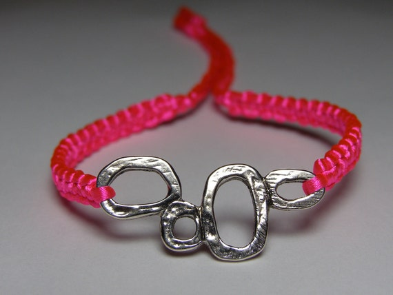 Neon pink satin bracelet with silvery finding