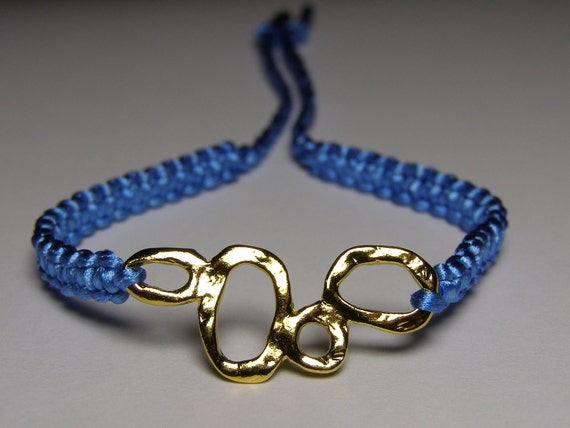 Sky blue bracelet with bubbly goldish finding