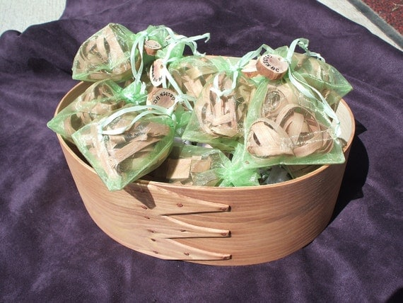 Twelve air fresheners for drawers and hope chests, juniper wood..in pretty organza bags.