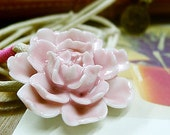 Hand-made porcelain Pendant. Pink Blooming Flower.