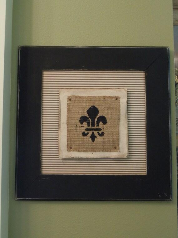 Distressed black 17 inch by 17 inch striped fleur de lis frame