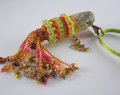 Shakesphere River Pup Vintage Fishing Lure Necklace Beaded in Pinks, Greens, and Browns