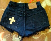 Size 25 Black distressed high waisted shorts with gold cross stud detail.