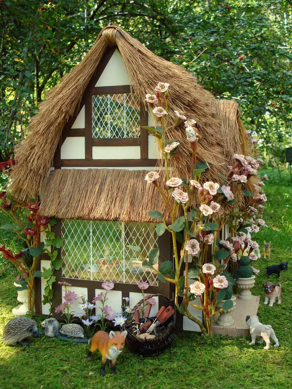 thatched roof fairy dollhouse cottage