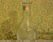 Vintage pressed glass decanter/bottle with tulip leaf style pattern