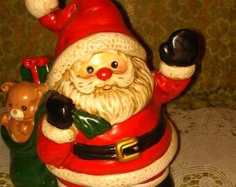 VTG 1985 Enesco Co. musical Santa with toy bag
