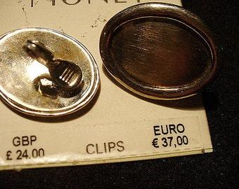 Vintage Monet Silvertone Oblong Clip Earrings